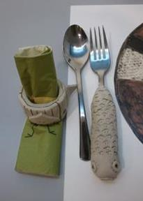 Ceramic napkin, spoon, fork and plate